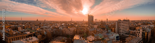 Poster de jardin Corail Panorama view of Riga city sunset near the old town including suspension bridge and main cathedral in the city center.