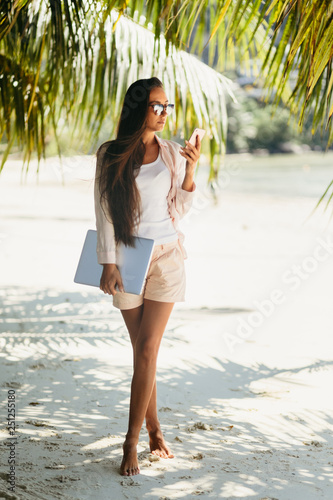 Woman freelancer on the beach Wallpaper Mural