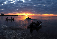 Fishermen Head Out In Their Boats At Sunrise To Go Fishing