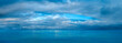 canvas print picture - Cloudy sky over the sea. Panorama of peaceful blue sky with puffy clouds. High resolution panoramic sky