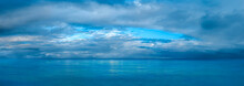 Cloudy Sky Over The Sea. Panorama Of Peaceful Blue Sky With Puffy Clouds. High Resolution Panoramic Sky