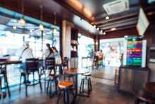 Blurred Background Image Of Coffee Shop. Abstract Blur Background With People In Cafe. Vintage Color Tone Style