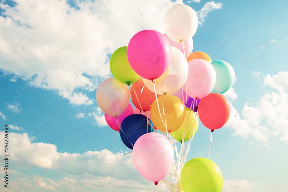 Fototapety, obrazy: Colorful festive balloons over blue sky with a retro vintage instagram filter effect.