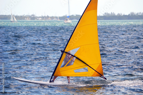 Fotografie, Obraz  Sailboarding on a windy afternoon in southeast florida