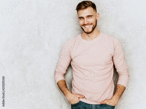 Fotografie, Obraz  Portrait of handsome smiling hipster lumbersexual businessman model wearing casual summer pink clothes