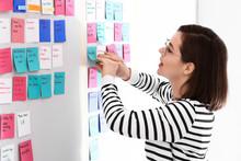 Young Woman Near Scrum Task Board In Office