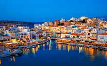 Agios Nikolaos Resort Town Skyline In The Evening And Voulismeni Lake In Crete Island, Greece.