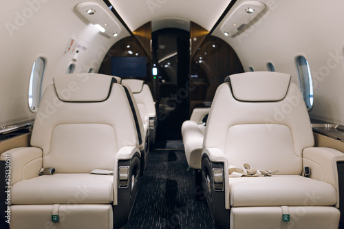 Photographie Business jet aircraft interior with comfortable leather seats