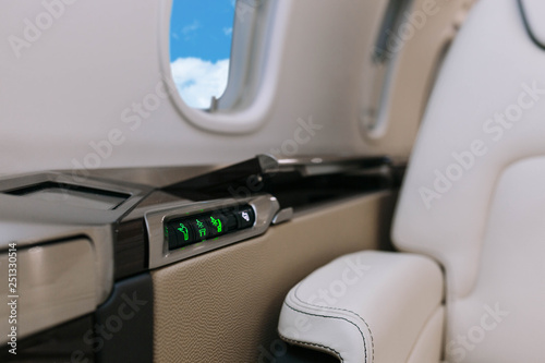 Tableau sur Toile Business jet aircraft interior with leather seats with control panel
