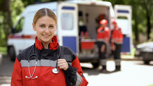 Female Paramedic Smiling Into ...