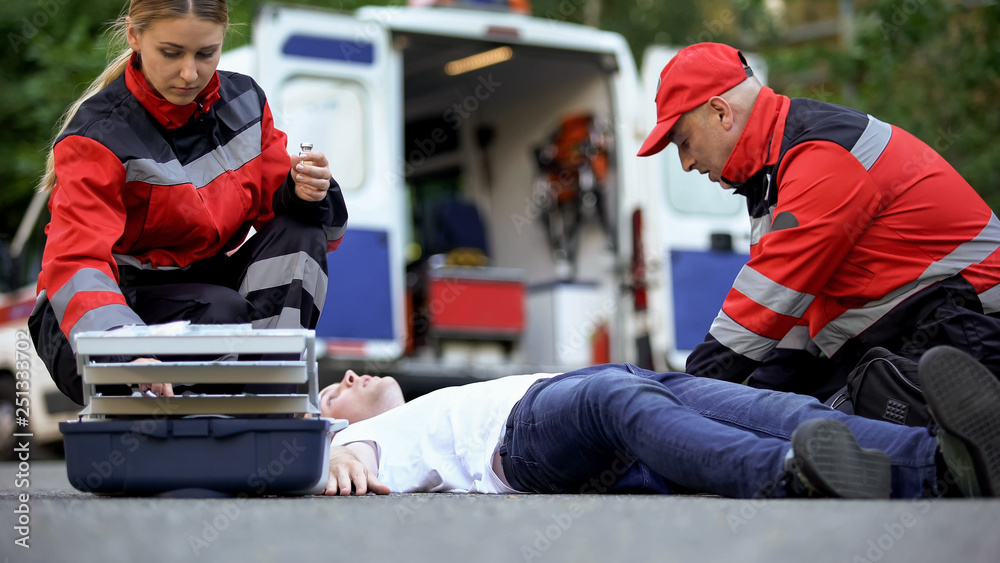 Fototapety, obrazy: Medics helping man on road, preparing insulin to unconscious diabetic, first aid