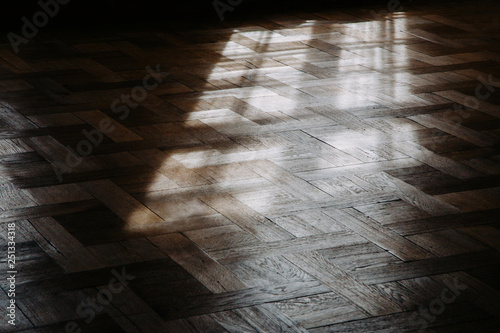 Obraz Wooden floor background in a morning light. Shadows of the window frame. Low angle view. - fototapety do salonu
