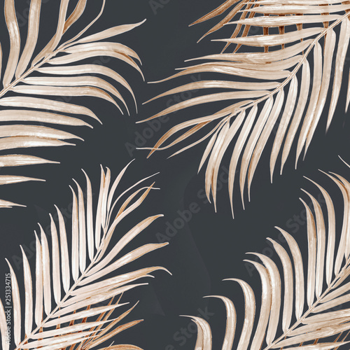 Light golden curved palm leaves pattern on dark background. Tropical concept....