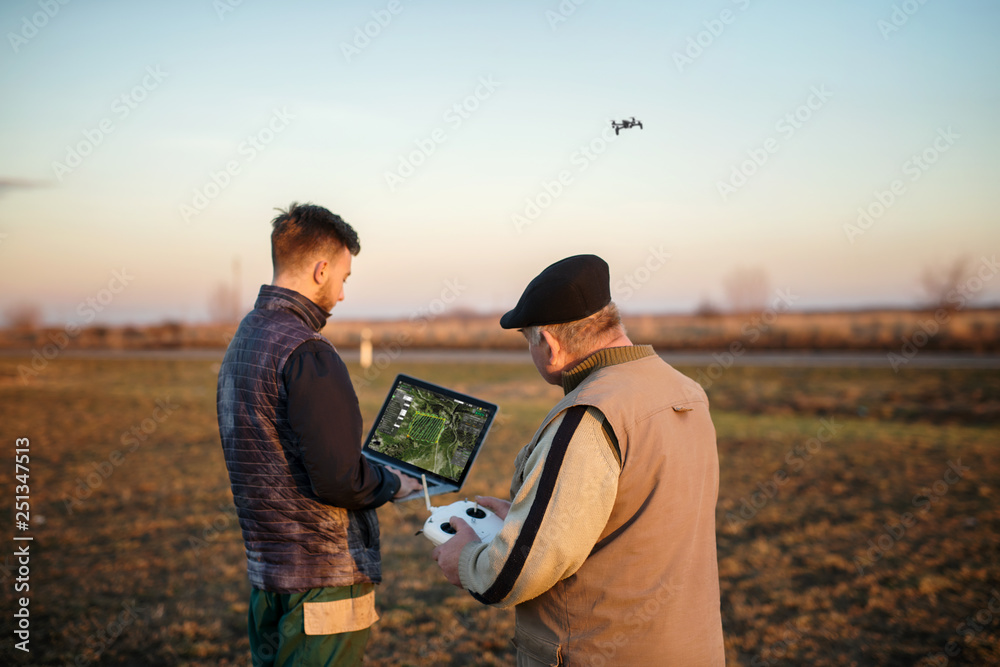 Fototapety, obrazy: Technician farmer use wifi computer control agriculture drone on field