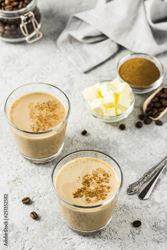 Keto bulletproof coffee in glasses  Selective focus, space for text