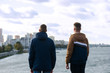Two guys are looking at the city