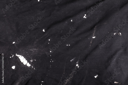 black old abstract weathered torn fabric background