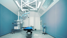 Background Of Hospital Empty Operation Room With Surgery Bed And Surgery Light