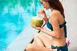 Woman drinking coconut drink