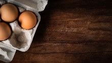 Fresh Brown Eggs In A Carton Box Was Placed On A Wooden Table To Prepare Food. Have Copyspace To Enter Text. In Aspect Ratio 16: 9. Useful For Health And Easy To Find According To The Supermarket.