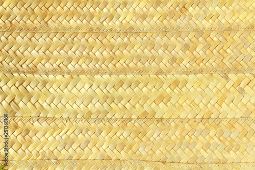 Fotografiet  woven palm tree leaves or bamboo chips mat texture background