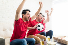 Die-Hard Soccer Fans Cheer The...
