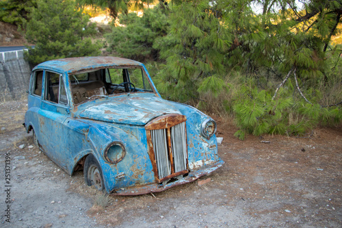 Photo Stands Vintage Poster old car next to the road in Greece