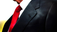 A Black Business Suit Jacket With White Shirt And Red Tie, Man Neck And Chest Close Up Texture Background With Copy Space.