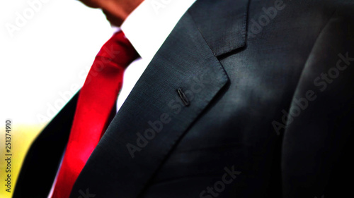a black business suit jacket with white shirt and red tie, man neck and chest close up texture background with copy space Fotobehang