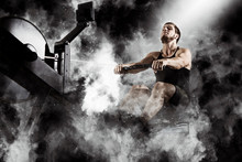 Bearded Fit Man Using Rowing Machine