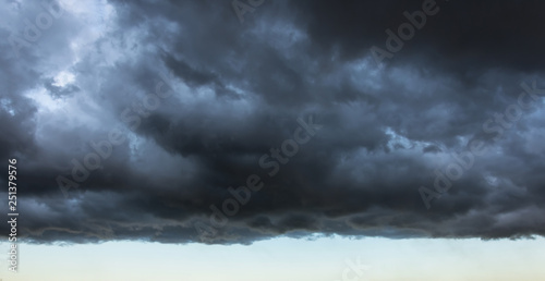 Fototapeta Dark cloud with a clear edge of the storm cloud, in front of a thundery front, w