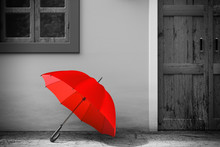 Red Umbrella In Front Of Retro Vintage European House Building In Monochrome Style, Narrow Street Scene. 3d Rendering