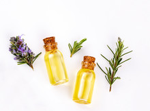 Rosemary Essential Oil In A Small Bottle. Natural Aroma Cosmetic Oil