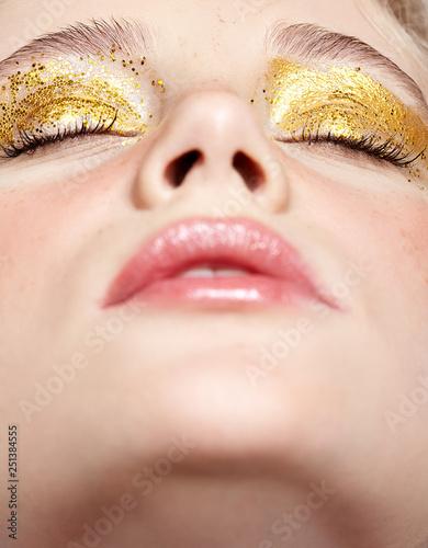 Foto op Plexiglas Beauty Closeup macro shot of closed human female face with yellow smoky eyes beauty makeup.