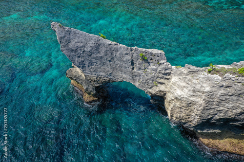 Valokuva  Aerial view of Atuh beach, rock gates in ocean, Nusa Penida, Bali, Indonesia