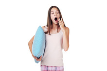 Young Girl Yawning And Holding...