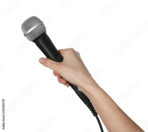 Obraz Woman holding dynamic microphone on white background, closeup - fototapety do salonu