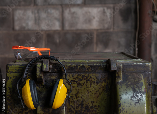 Photo Fluorescent Orange health and safety eye protection glasses and yellow ear prote