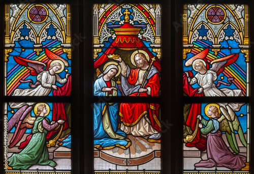 PRAGUE, CZECH REPUBLIC - OCTOBER 12, 2018: The Coronation of Virgin Mary on the windowpane in church Bazilika svatého Petra a Pavla na Vyšehrade by František Sequens end. of 19. cent.
