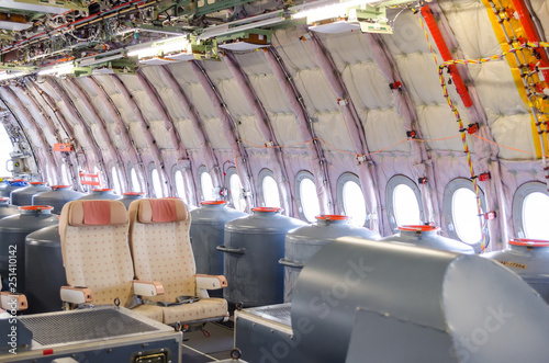 Carta da parati View on the cabin of the with seats aircraft, without interior trim, for test fl