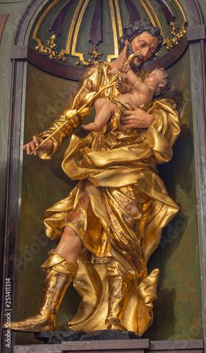 PRAGUE, CZECH REPUBLIC - OCTOBER 16, 2018: The carved polychrme statue of St. Joseph in church kostel Svatého Havla by unknown baroque artist.