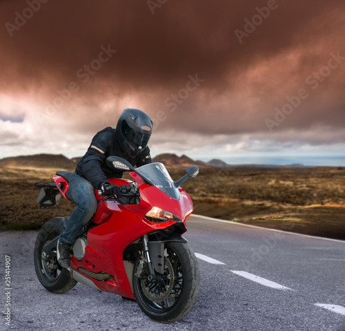red Biker on a volcanic landscape