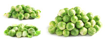 Set Of Fresh Brussels Sprouts On White Background
