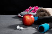 Pair Of Sport Shoes, Apple, Meetr And Towel On Red Background. Copy Space. Flat Lay – Image