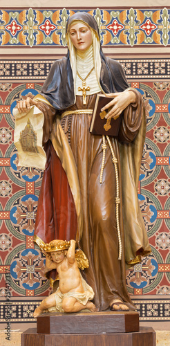 PRAGUE, CZECH REPUBLIC - OCTOBER 17, 2018: The carved statue of St. Agnes of Bohemia in church Svatého Cyrila Metodeje by Bretislav Kafka (1891 - 1967).