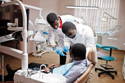 African american man patient in dental chair  Dentist office