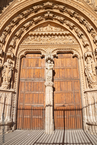 PALMA DE MALLORCA, SPAIN - JANUARY 30, 2019: The south portal of cathedral La Seu with the stone relief of Last Supper by masters Pere Morey, and Guillem Sagrera Sagrera (1389 - 1394).