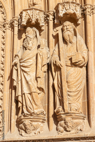 PALMA DE MALLORCA, SPAIN - JANUARY 30, 2019: The detail of south portal of cathedral La Seu with the statue of apostles by masters Pere Morey, and Guillem Sagrera Sagrera (1389 - 1394).