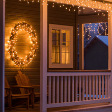 Fairy Lights And Christmas Wreath On House