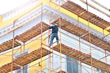 Worker On A Building Facade Restoration